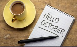 Hello October – Handwriting In A Notebook With A Cup Of